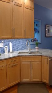 kitchen sink with blue tiling and cabinets - kitchen remodeling in Broomall - Teknika