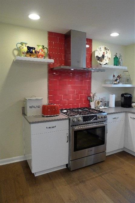 kitchen with red backsplash - Teknika Kitchens and Baths ...