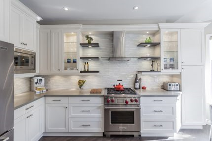 white custom kitchen with stainless appliances and shelving over the stove- Custom Kitchen Cost - Teknika Kitchens & Baths